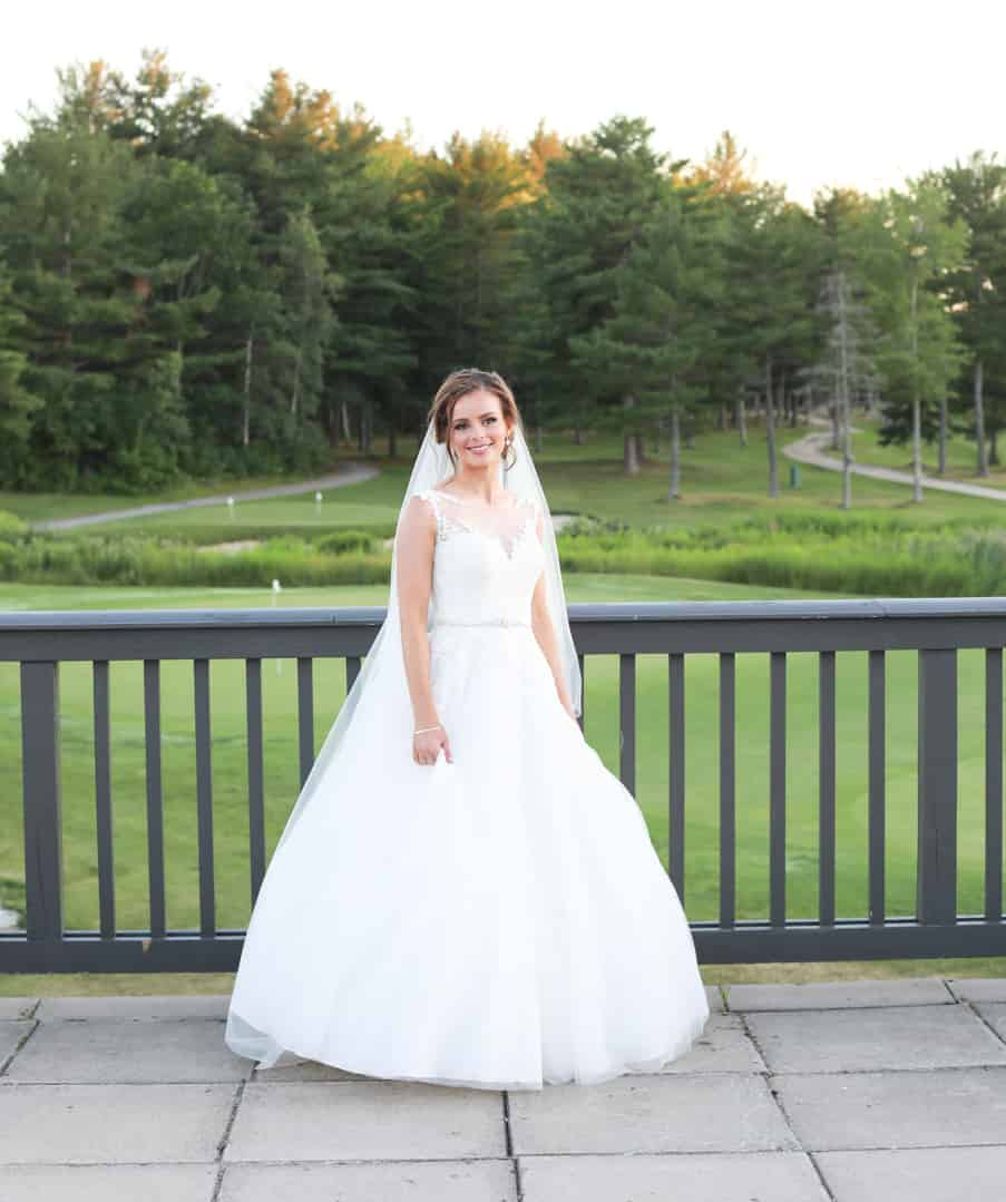 Bride on a balcony overlooking golf course