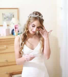 Bride getting reading her love letter from her husband to be