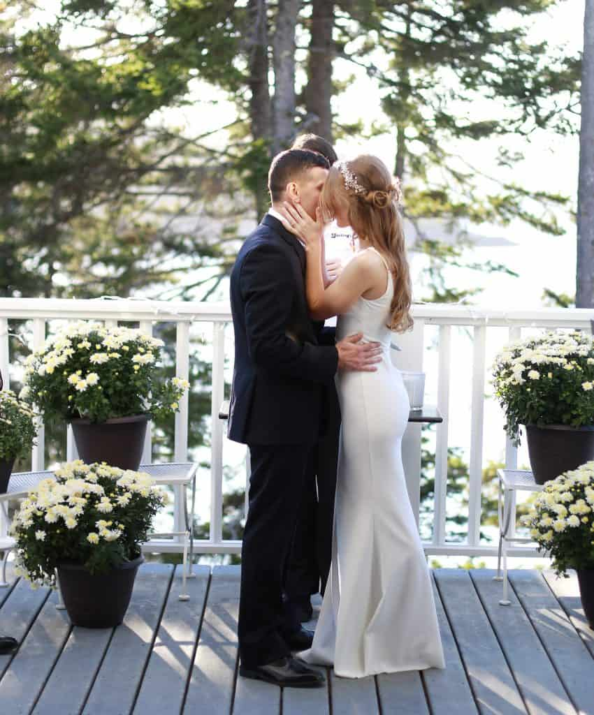 Bride and groom sharing the first kiss as husband and wife