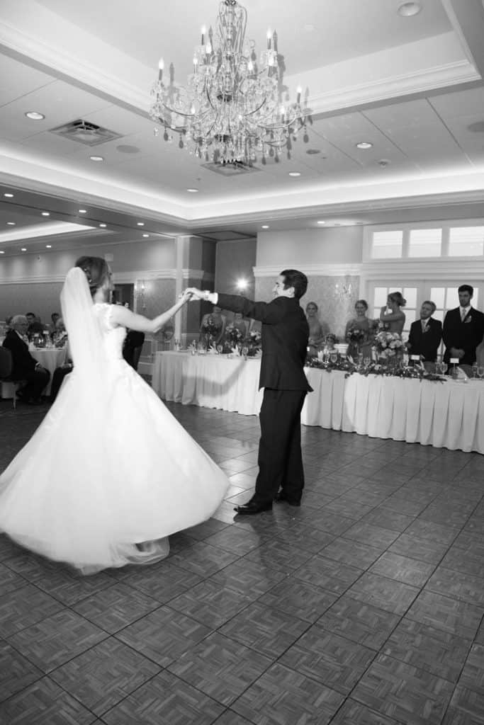 bride and groom dancing, wedding reception, black and white photo