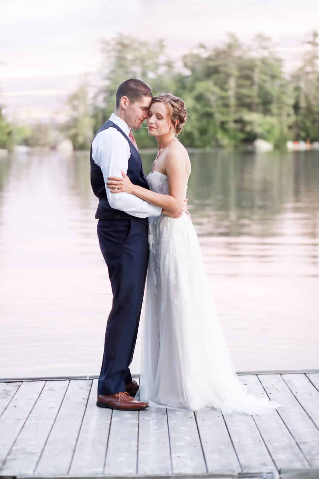 bride and groom portrait on dock at Alamoosook Lakeside Inn in Orland Maine