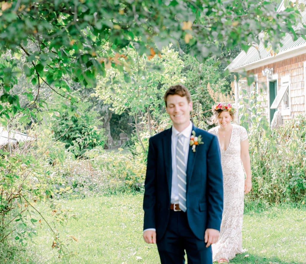 first look, groom look at the camera, bride behind her groom