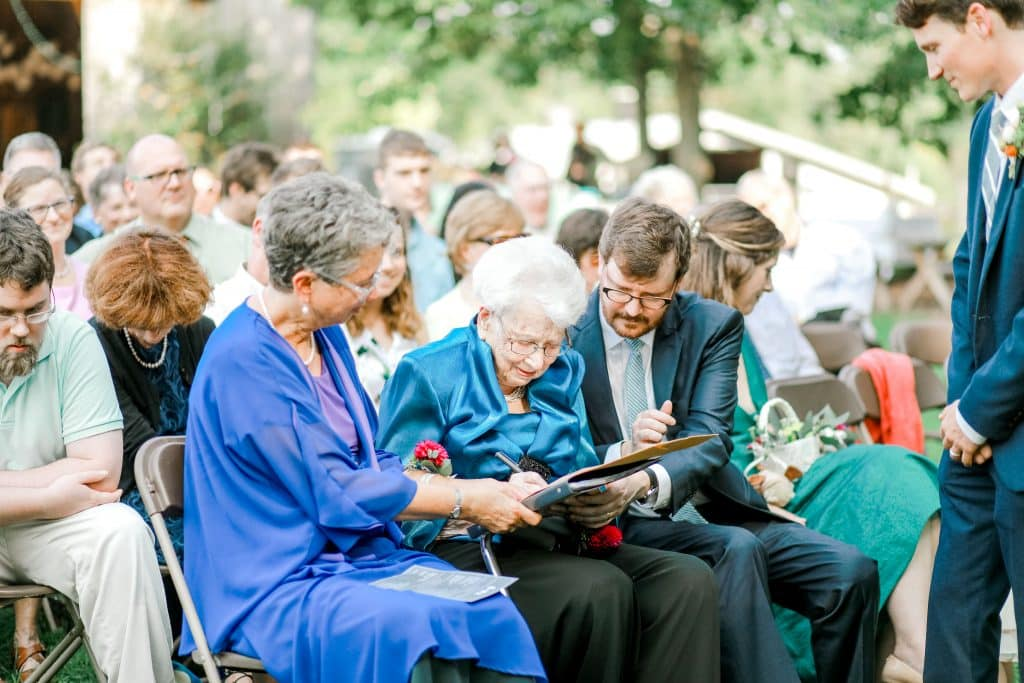 Mother of the bride and grandmother of the bride. Grandmother signing the marriage certificate.