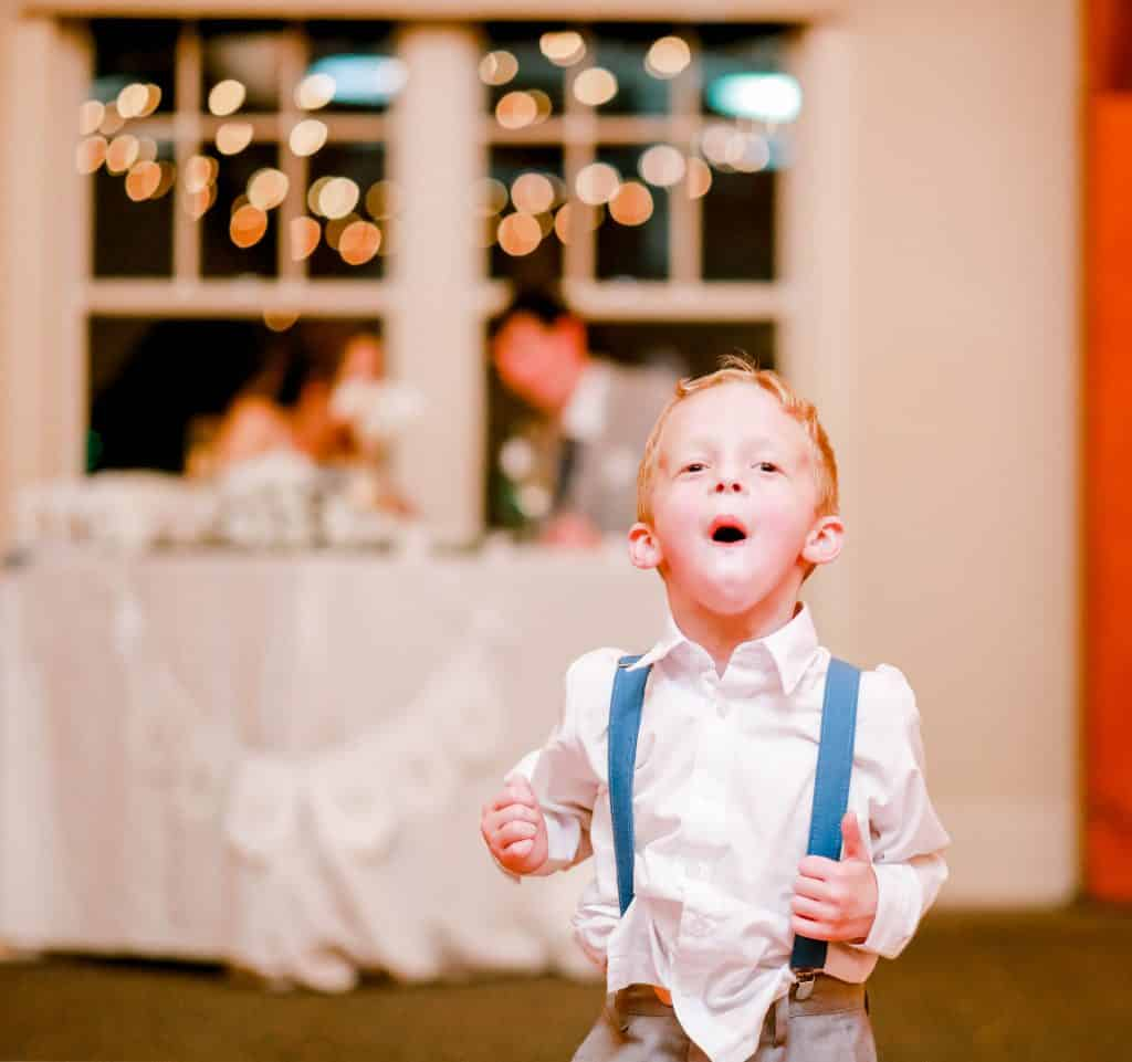 ring bearer excited for dancing looking at the camera