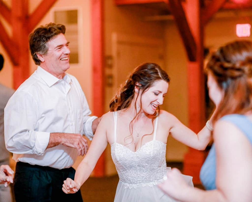 bride dancing during reception candidly
