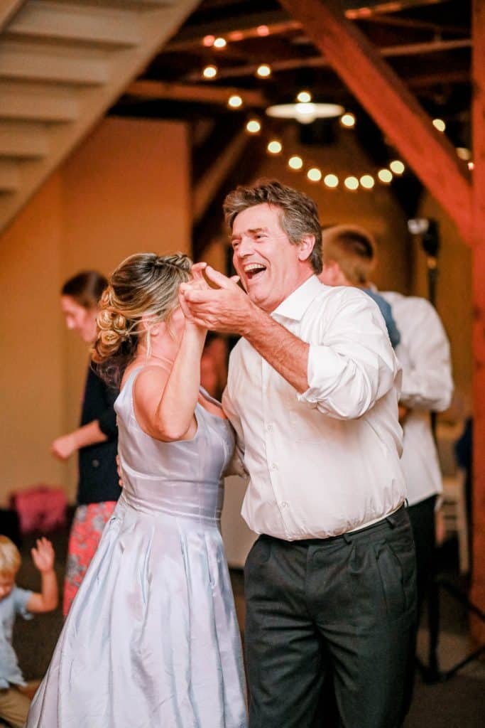 bride dancing with her step father