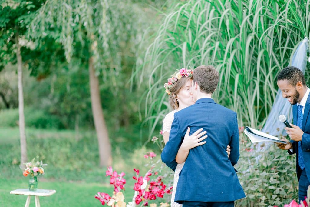 Bride and Groom kissing for the first time as husband and wife outside