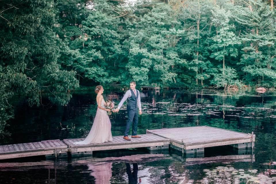 bride and groom on dock at maine lake wedding venue Alamoosook lakeside inn