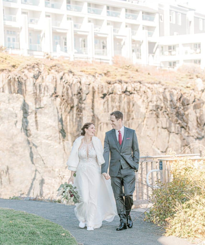 bride and groom walking at the Cliff House