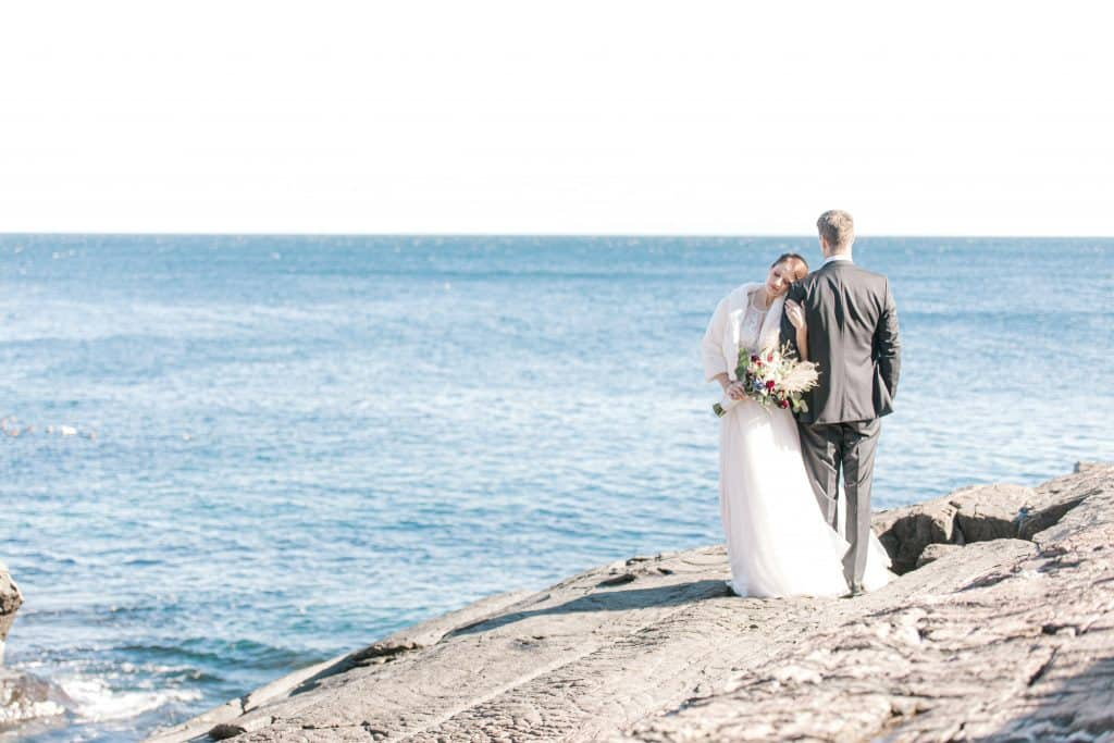 Bride and groom on the cliffs at the Cliff House