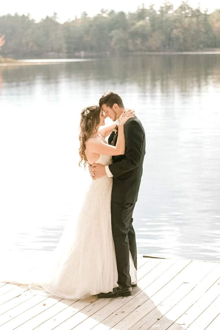 bride and groom on a maine lake