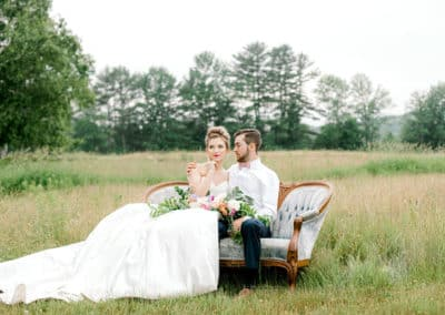 bride and groom on a couch for a photography session in maine