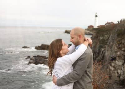engaged couple maine lighthouse