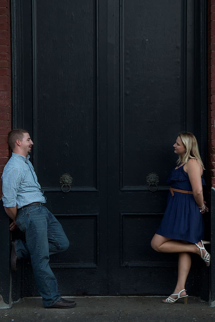 engagement photos in front of large door in maine